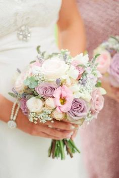 Dainty bouquet. Adds nice contrast to the large and sometimes heavy bouquets lots of people go for. This is very sweet with pink and white lisianthus, lavender roses, queen-anne's-lace, eucalyptus, and white veronica.