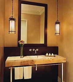 This stunning bath mixes the old with the new seamlessly. A honey onyx console sink like this would be a sign of wealth today.