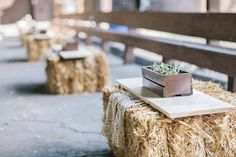 Bales of hay as coffee tables for extra seating, covered with vintage linens, and wood