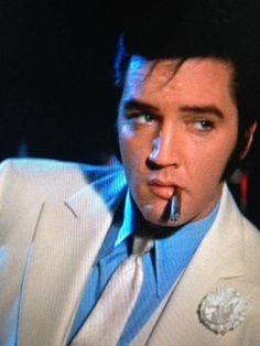 Elvis Presley on a scale of 1-10 definitely a 10. Whew! Smoking a thin German cigar.