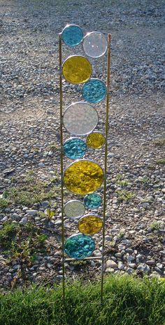 I would want a soft green in place of the blue .. but wouldn't this be nice in a plant by the window inside ! or .. spray foam in a pot with moss, beach glass, stones or pebbles on top to finish. - stained glass garden art stake yellow teal blue yard decoration. 35oo, via Etsy.