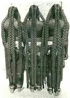 This hairstyle are called the Eembuvi Braids, worn by women of the Mbalantu tribes from the Namibia. It's a style that requires preparation from a young age, usually around twelve years old, when Mbalantu girls use thick layers of finely ground tree bark and oils– a mixture that is said to be the secret to growing their hair to such lengths!