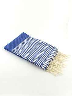 This extremely thin towel from Scents and Feel is their classic fouta towel modernized and revised to add uniqueness by adding stripes on each side to create a positive/negative design.