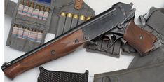 The TP-82 survival rifle for cosmonauts. Two shotgun barrels mounted over a 5.45x39mm rifled barrel, with a detachable stock that doubles as a machete.