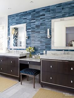 Tile can add the wow factor to a room that's otherwise neutral. Here, a selection of ocean-blue hues offers a welcome color boost to the contemporary materials and clean lines. Larger tiles in a cool beige color repeat the shape on the floor.
