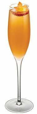 - 1 oz. Whaler's Pineapple Paradise Rum  - Champagne  - 1/2 oz. Grand Marnier  - Dash of grenadine syrup  - 1 oz. pineapple juice  Garnish: strawberry slice