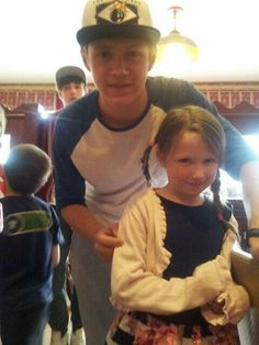 There is nothing cuter than Niall with a little fan. He doesn't look interested with older fans, but he always looks excited with the young ones!<<< yah.. I wanna know you the boy in the back is xD