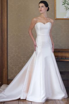 A strapless fit and flare gown with a gentle sweetheart neckline. The back curves to a gentle wide V and features a train.