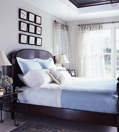 Dark wood and soft colors add a sense of elegance to this calming bedroom. More neutral bedrooms: http://www.bhg.com/rooms/bedroom/color-scheme/neutral-bedroom-colors/#page=4