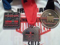 Time to get another one. These are from 2007, 2009, and 2012, first Ironman post cancer.