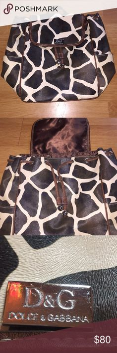 D&G Leather Animal Print Bag Beautiful backpack! A few flaws which are pictured in the last 3 photos but barely noticeable! Drawstring close and 2 extra pockets on the sides as well as inside! D&G Bags