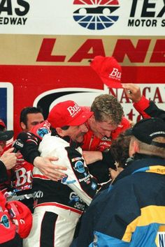 celebrating with his legendary father, Dale Earnhardt, in Victory Lane after winning the first NASCAR Winston Cup Series race of his career. Indy Car Racing, Indy Cars, Nascar Cars, Dale Earnhart Jr, Daytona 500 Winners, Rusty Wallace, The Intimidator, Nascar Sprint Cup, Motor Speedway