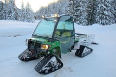 John Deere Gator on tracks. Now that's my way to snowmobile ;)