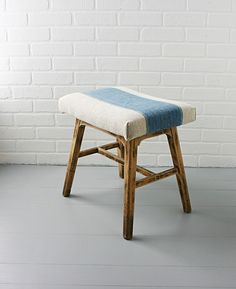 antique stool with grain sack cushion.