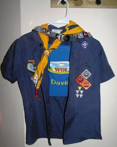 Cub Scout Organizer Hanger. This is a great idea for the younger scouts. I'm always looking for my sons uniform pieces.