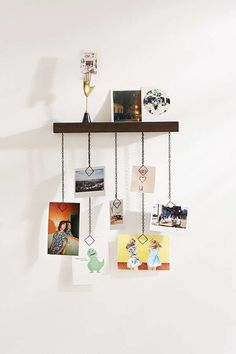 This display shelf with clip chains is the perfect way to show off mini pieces with a little industrial style.