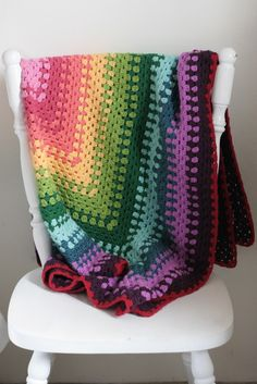 Rainbow granny square crochet blanket by Katie's Kitchen