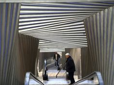 An undulating escalator cover turns the mundane into art. Designed by Roberto Ercilla