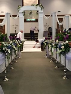 Fresh hydrangea, roses, orchids, stock & wax flower were the main floral focus for for this Jan.2016 wedding. Colors were  smoke blue, plum & silver grey.