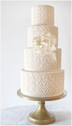Heart of Gold Wedding Cake / http://www.deerpearlflowers.com/32-wedding-cakes-with-classical-details/