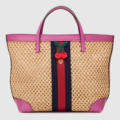 Gucci children's straw effect tote with pink leather trims and blue/red/blue heart web.