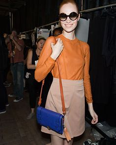 Loving how well this Yigal Azrouel bag coordinates with her burnt orange outfit.