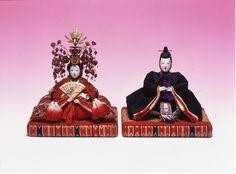 a set of ornamental dolls (雛人形, hina-ningyō?)  representing the Emperor, Empress