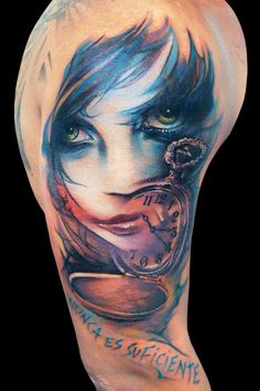 """Abstract #tattoo of #girl and #pocketwatch. The Spanish translates literally to """"Nothing is enough."""""""