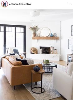 Tulsa Remodel Reveal Modern White Farmhouse black windows and doors modern leather sofa article sven sofa white brick fireplace wood beam mantle tv gallery New Living Room, Living Room Sofa, Apartment Living, Home And Living, Living Room Furniture, Living Room Decor, Modern Living, Small Living, Apartment Ideas