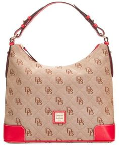 Hello, hobo. A pop of colorful leather highlights the shoulder-right shape of this Dooney & Bourke favorite featuring a divided interior and signature monogram. | Imported | Cotton; handles & trim: le