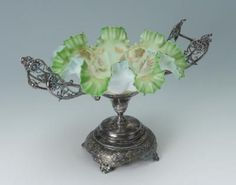 VICTORIAN ART GLASS BRIDES BASKET: Double handle silverplate stand, green glass bowl with ruffled edge, enamel floral decoration.