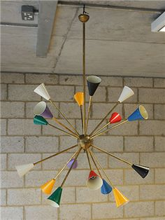 I'm in love with this large, colourful Italian 'Stilnovo' mid-century chandelier with metal shades on a brass frame. I think it would work really well in a modern open-plan living kitchen.