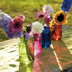 Twelve Bright Jars - NEW    In 4 jewel-like colours these glass jars make standout decorative features with informal flower arrangements or hanging from trees. Hand wash only.