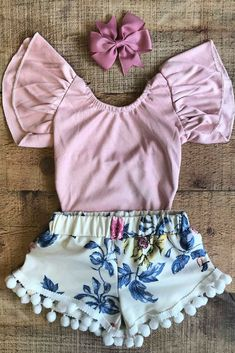 This pom pom shorts and baby girl bodysuit pair perfectly together for your baby girl! Perfect summer outfits for girls boutique clothing! Free shipping over $50! #babygirl #pompomshorts #floralshorts #leotard #bodysuit