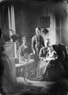 feuille-d-automne:Unidentified group of three women and child in an interior , c 1880 .