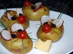 Potato Mouse Recipe  Recipe    Ingredients:  Small potato  Cherry tomatoes  Green onion  Raisins  Rabanete  Directions:  Bake the potato, remove the inside carefully not to break the skin, make a potato cheese filling.  Use cherry tomato for the nose, raisins for eyes, rabanete for ears and green onions for tail and whiskers.  Use a small piece of cheese to place it on the mouse's mouth.