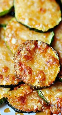 Baked Parmesan Zucchini Rounds | A simple summer side dish of Baked Parmesan Zucchini Rounds comes together quickly using only two ingredients…and will disappear from the table even faster!