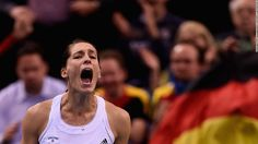 The US Tennis Association has apologized to the German Fed Cup team for playing the Nazi-era national anthem ahead of a replay match in the women's tournament.