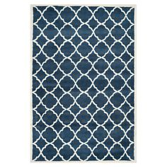 Anchor your living room seating group or welcome guests in the foyer with this hand-tufted wool rug, showcasing a trellis motif in blue and ivory. ...