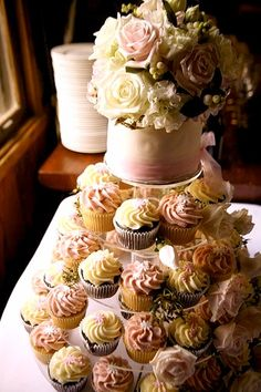 floral wedding cake and cupcakes