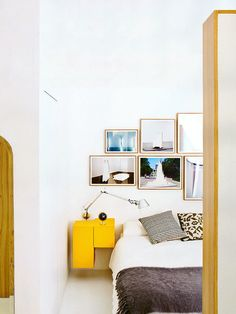 floating nightstand gallery wall behind bed