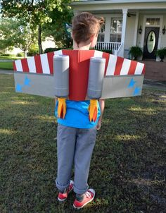 Your kid's Halloween costume will take off with this fun take on RocketMan! Your kid's Halloween costume will take off with this fun take on rocketman. The best part: it can be made with a cardboard box. Space Costumes, Robot Costumes, Diy Costumes, Cardboard Costume, Cardboard Toys, Halloween Party Kostüm, Halloween Costumes For Kids, Airplane Costume, Educational Crafts