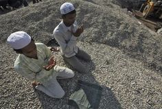 Muslim pray on a heap of crushed stones during Eid al-Adha outside Jamia Masjid, which is undergoing construction, in Jammu October 27, 2012. REUTERS-Mukesh Gupta