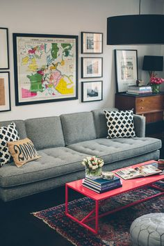 love the graphic pillows + pink coffee table. what's up with that 2008 pillow though? 2000, and late?