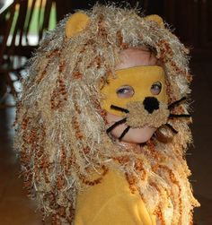 My granddaughter wanted to be a lion for halloween. I knew what I wanted the mane to look like, but wasn't sure how to go about it. I found a free pattern on Lion Brand Yarn's website for a wild red wig (http://www.lionbrand.com/patterns/60386.html?noImages=0)and knew that I could make it work.First I bought four different kinds of yarn: different colors and textures. Then I crocheted the cap and just followed the directions in the pattern. The only things I changed were the length of the…