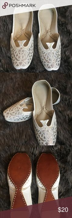 New Embroidered flats from India Wedding bridal New shoes. Bought these in India a couple years ears ago. I bought way too many, so I'm selling a few pars.  Very comfy, the shoes will mold to your foot as you where them for a personalized fit.   Size will fit a 6.5 or 7. I'm a size 7 and they fit me. Shoes Flats & Loafers