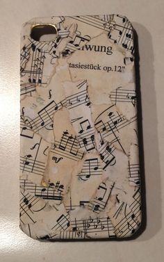 I just decorated this phone case out of old piano sheet music I had! Make it look vintage with a tea bag and use paper mâché (glue,water,flour) as a paste to stick. Optional coat of clear nail polish to finish it off. *suggestion* use something unique to make it special for you!