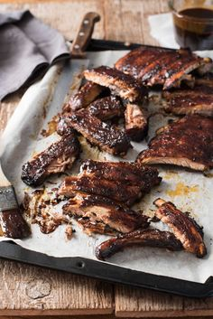 Oven Baked Barbecue Pork Ribs - rubbed with spices, baked until fall apart tender then finished with an incredible homemade barbecue sauce!
