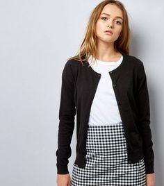 """Opt for this crew neck cardigan on casual days this season. Try complementing with a t-shirt, gingham check print skirt and trainers for a chic finish.- Crew neckline- Button front fastening- Simple long sleeves- Soft finish- Casual fit that is true to size- Maddy is 5'8.5""""/174cm and wears UK 10/EU 38/US 6"""