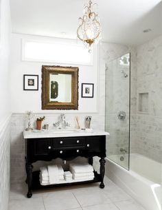 Make a small bathroom appear bigger with glass shower doors and an open vanity.  White tile helps too. #bathing beauties